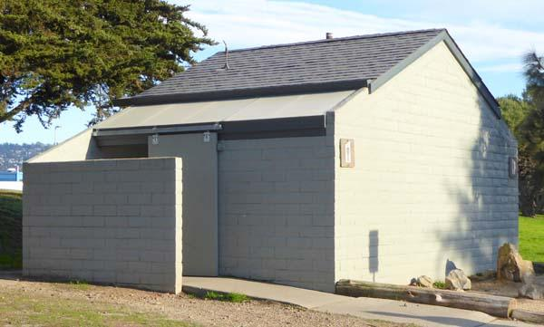 Permanent rest room with flush toilet and cold water sinks, near Mudpuppy's at Point Isabel Regional Shoreline