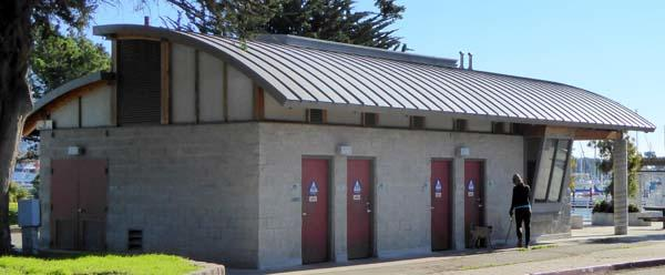Restrooms at Berkeley Yacht Basin, about 150 yards from Cesar Chavez Park boundary, feature flush toilets,.
