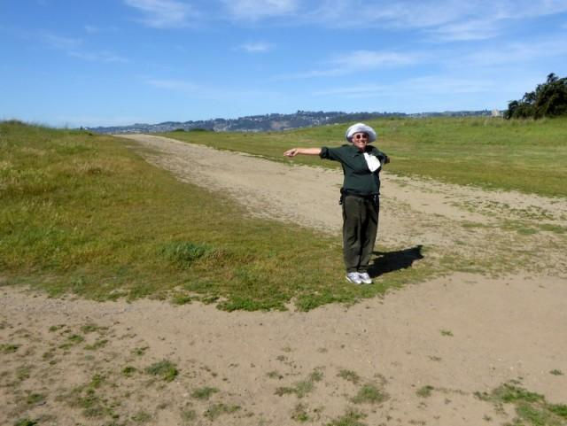 Mester posing at the trail junction where a leash sign would be useful to give notice to dog owners.