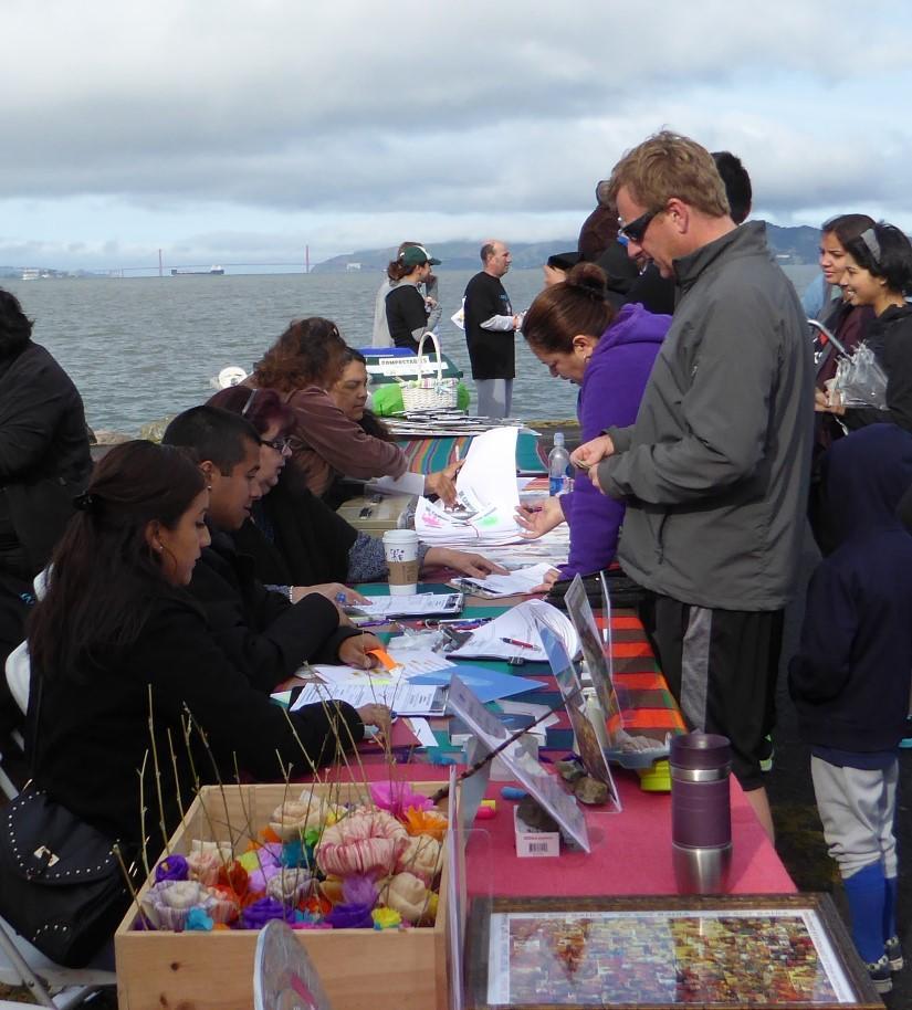 Volunteers register runners and walkers