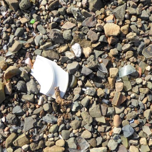 The beach north of the culvert is a heap of broken glass